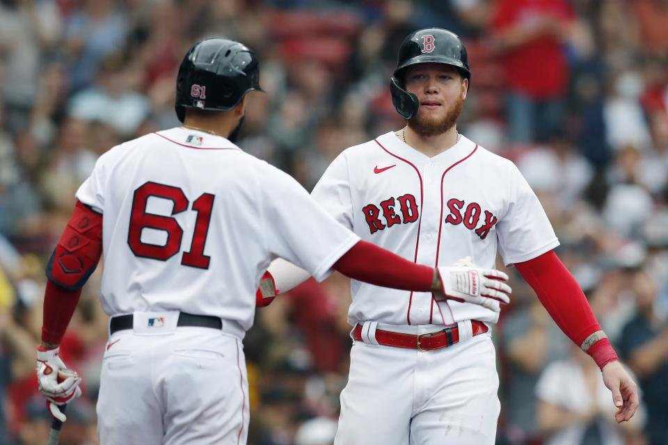 Boston Red Sox's Alex Verdugo celebrates with Jack Lopez (61) after scoring on a double by Travis Shaw during the fifth inning of a baseball game against the Cleveland Indians, Sunday, Sept. 5, 2021, in Boston. (AP Photo/Michael Dwyer)