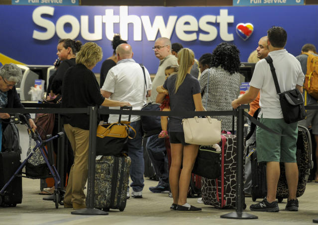 <p>Passengers wait in line at the Southwest Airlines ticket counter Wednesday, Sept. 6, 2017 at Tampa International Airport. Many passengers were leaving Tampa on Wednesday ahead of Hurricane Irma which is threatening the Florida peninsula. (Photo: Chris Urso/Tampa Bay Times via AP) </p>