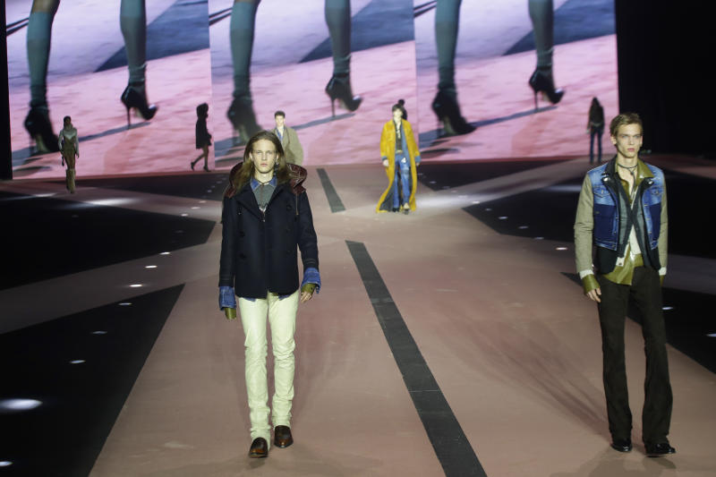 Models wear creations as part of the Dsquared2 men's Fall-Winter 2020/21 collection, that was presented in Milan, Italy, Friday, Jan. 10, 2019. (AP Photo/Luca Bruno)