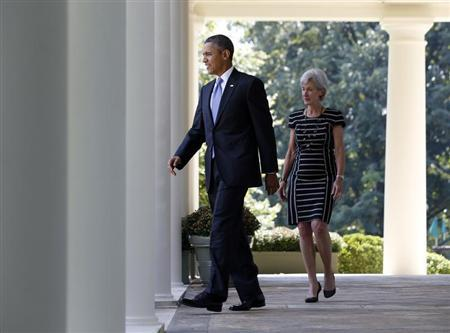 U.S. President Barack Obama and Health and Human Services Secretary Kathleen Sebelius walk from the Oval Office to the Rose Garden of the White House in Washington