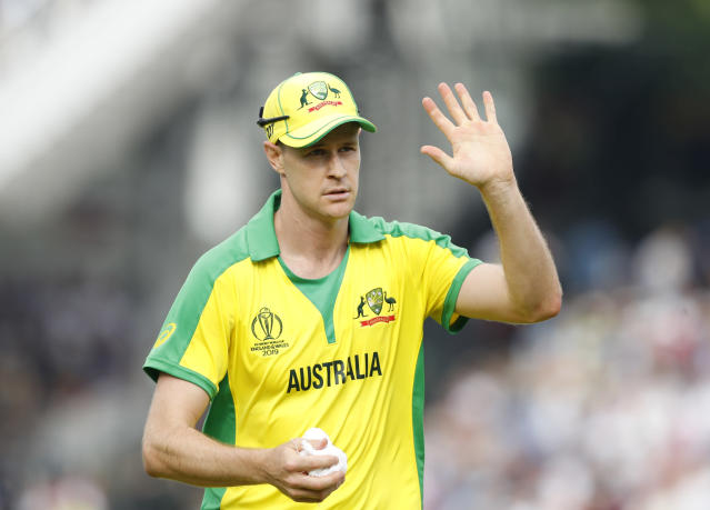 Australia's Jason Behrendorff acknowledges the crowd after taking the wicket of England's Jofra Archer during the Cricket World Cup match between England and Australia at Lord's cricket ground in London, Tuesday, June 25, 2019. Australia won by 65 runs with Behrendorff taking 5 wickets. (AP Photo/Alastair Grant)