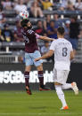 Colorado Rapids midfielder Jack Price (19) heads the ball near Real Salt Lake midfielder Damir Kreilach (8) during the first half of an MLS soccer match Saturday, Aug. 21, 2021, in Commerce City, Colo. (AP Photo/ Jack Dempsey)