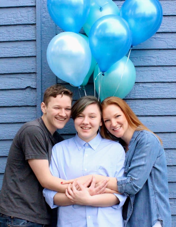 Adrian (centre) poses with mum Heather and brother Lucas. Photo: Supplied/Facebook/HeatherLundbergGreen