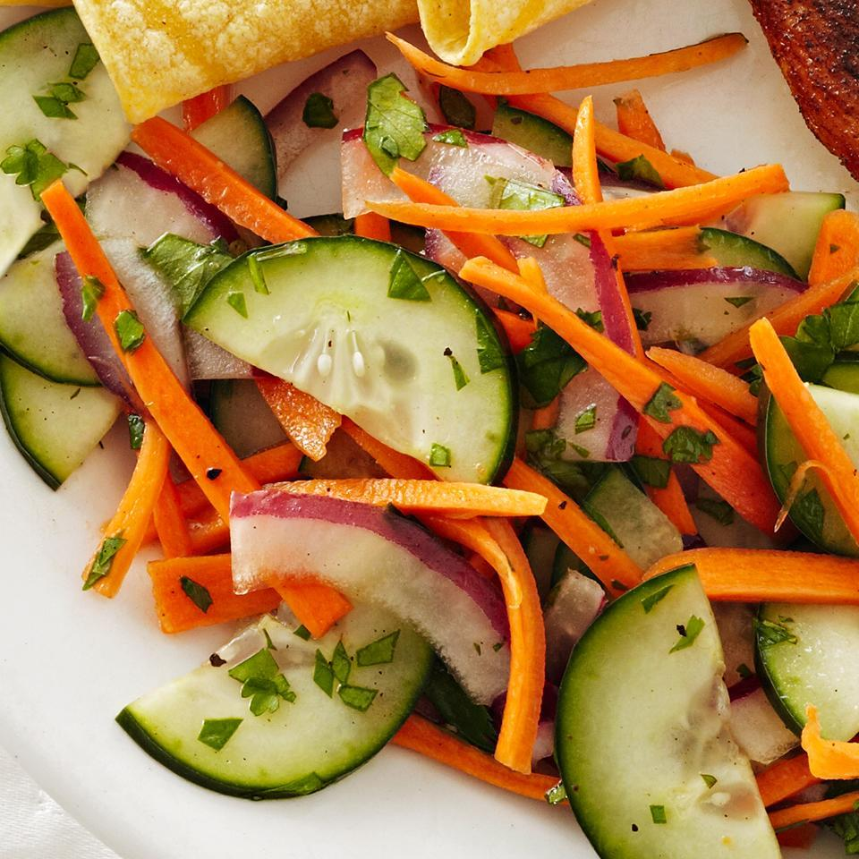 """<p>Carrot salads are refreshing, and this one--with cucumbers, red onion and a zesty cilantro-chili vinaigrette--is sure to become a new favorite. It's excellent served with grilled fish. <a href=""""http://www.eatingwell.com/recipe/265759/carrot-cucumber-salad/"""" rel=""""nofollow noopener"""" target=""""_blank"""" data-ylk=""""slk:View recipe"""" class=""""link rapid-noclick-resp""""> View recipe </a></p>"""