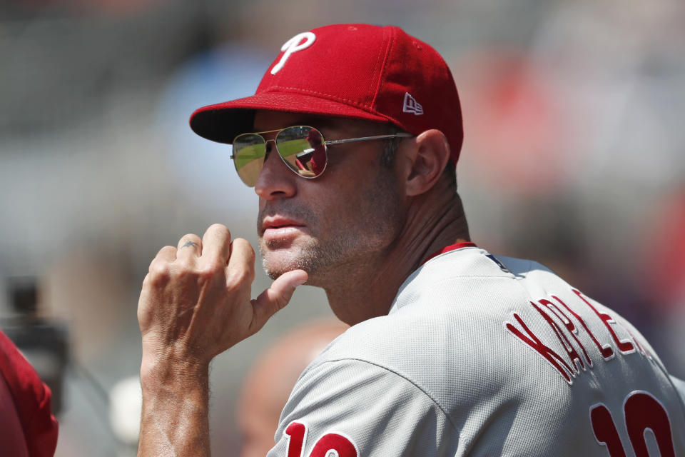 Philadelphia Phillies manager Gabe Kapler (19) watches from the dugout during a baseball game against the Atlanta Braves Thursday, Sept. 19, 2019, in Atlanta. (AP Photo/John Bazemore)
