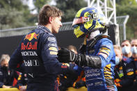 First placed Red Bull's Max Verstappen, left, greets third placed McLaren's Lando Norris at the end of the Emilia Romagna Formula One Grand Prix, at the Imola racetrack, Italy, Sunday, April 18, 2021. (Bryn Lennon/ Pool Via AP)