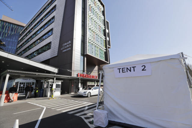 Two tents stand at the emergency entrance to Seattle Children's Hospital, March 18. (Elaine Thompson/AP Photo)