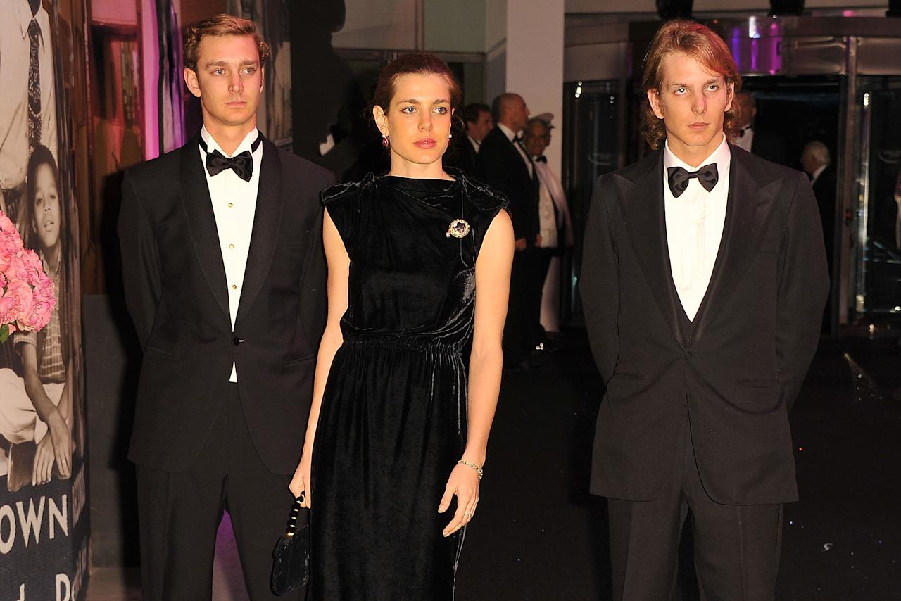 MONTE CARLO, MONACO - MARCH 19:  Pierre Casiraghi, Charlotte Casiraghi and Andrea Casiraghi attend the Monaco Rose Ball 2011 at Sporting Monte Carlo on March 19, 2011 in Monte Carlo, Monaco. This year's Rose Ball will not be attended by the Royal family as they are in mourning after Princess Antoinette of Monaco passed away on Friday at the age of 90.  (Photo by Pascal Le Segretain/Getty Images)