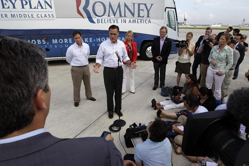 Republican presidential candidate, former Massachusetts Gov. Mitt Romney, accompanied by Florida Attorney General Pam Bondi, right, and Sen. Marco Rubio, R-Fla., speaks to reporters on the tarmac at Miami International airport, Monday, Aug. 13, 2012, in Miami, Fla. (AP Photo/Mary Altaffer)