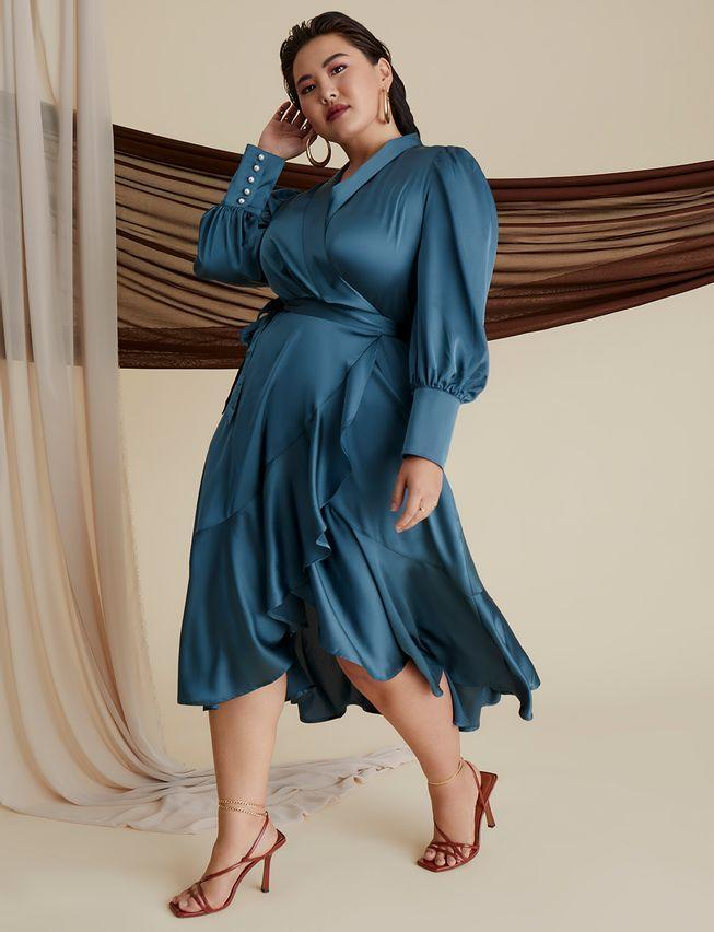 """<h2>Eloquii Bishop Sleeve Wrap Dress </h2><br>For a more traditional workplace, this Eloquii wrap-front dress strikes the perfect balance between trend-driven and classic. The silky satin material and the bishop-style sleeves are the details that take this classic wrap dress up a notch. <br><br><em>Shop <strong><a href=""""https://www.eloquii.com/bishop-sleeve-wrap-dress/1247419.html"""" rel=""""nofollow noopener"""" target=""""_blank"""" data-ylk=""""slk:Eloquii"""" class=""""link rapid-noclick-resp"""">Eloquii</a></strong></em><br><br><strong>Eloquii</strong> Bishop Sleeve Wrap Dress, $, available at <a href=""""https://go.skimresources.com/?id=30283X879131&url=https%3A%2F%2Fwww.eloquii.com%2Fbishop-sleeve-wrap-dress%2F1247419.html"""" rel=""""nofollow noopener"""" target=""""_blank"""" data-ylk=""""slk:Eloquii"""" class=""""link rapid-noclick-resp"""">Eloquii</a>"""