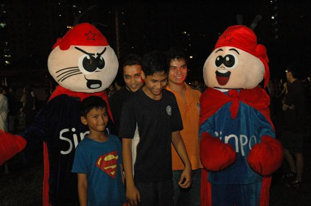 Two versions of Sinpo, the SDA mascot, pose with a group of young boys at an SDA rally. (Yahoo! photo)