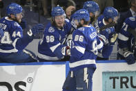 Tampa Bay Lightning right wing Nikita Kucherov (86) celebrates his goal with teammates during the third period in Game 1 of the NHL hockey Stanley Cup finals against the Montreal Canadiens, Monday, June 28, 2021, in Tampa, Fla. (AP Photo/Phelan Ebenhack)