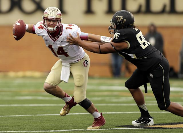 Florida State quarterback Jacob Coker tries to avoid Wake Forest defensive end James Looney in the second half of an NCAA college football game in Winston-Salem, N.C., Saturday, Nov. 9, 2013. Florida State won 59-3. (AP Photo/Nell Redmond)