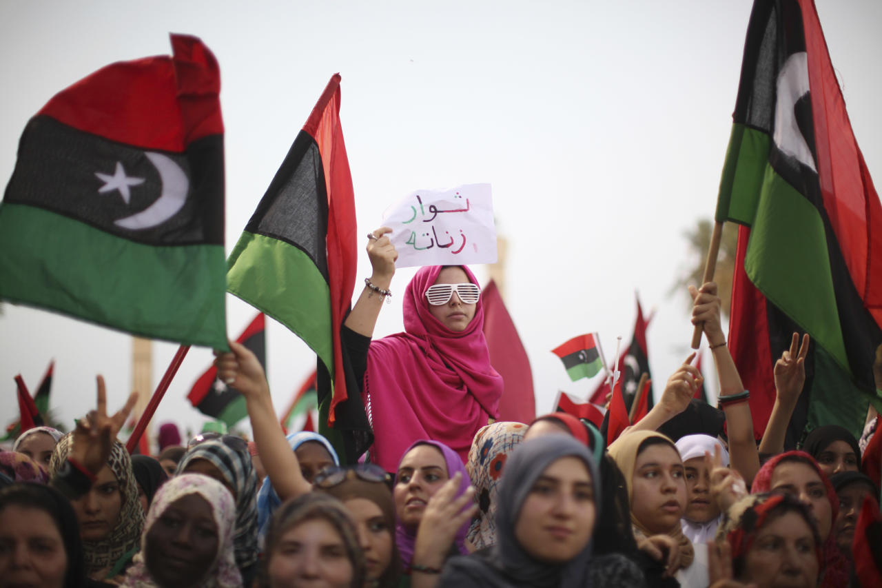 "Women celebrate the revolution against Moammar Gadhafi's regime and ask for more women's rights in Tripoli, Libya, Friday, Sept. 2, 2011. Rebel forces are advancing toward Moammar Gadhafi's hometown Sirte despite the extension of a deadline for the town's surrender, rebel officials said Friday, as a U.N. official warned that Libya faces critical but short-term shortages of drinking water, food and other supplies. The banner reads in Arabic: ""Revolutionaries of Zintan"". (AP Photo/Alexandre Meneghini)"
