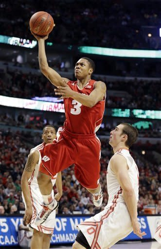 Wisconsin guard George Marshall (3) goes up for a basket during the first half of an NCAA college basketball game against the Ohio State in the championship of the Big Ten tournament Sunday, March 17, 2013, in Chicago. (AP Photo/Nam Y. Huh)