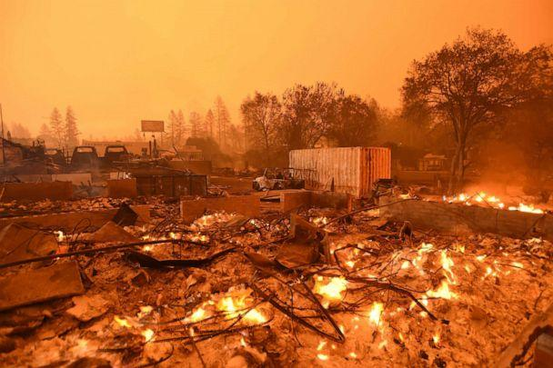 PHOTO: Businesses continue to burn under a darkened smokey sky in Paradise, north of Sacramento, Calif., Nov. 09, 2018. (Josh Edelson/AFP/Getty Images)