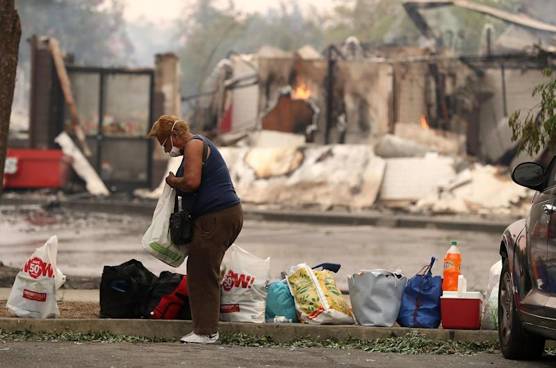 A resident goes through personal belongings in a parking lot in Santa Rosa.