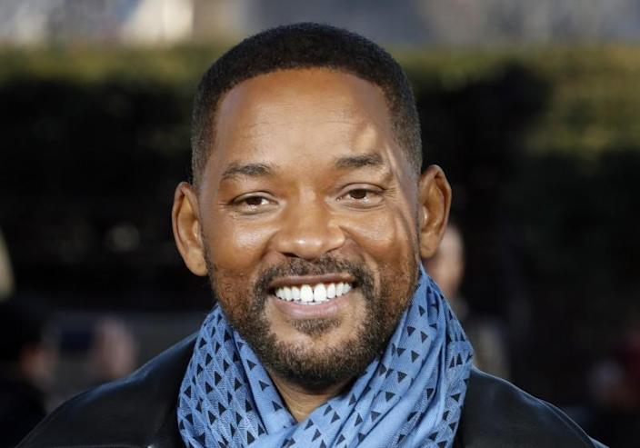"Will Smith smiles during a January 2020 photo call for ""Bad Boys for Life."""