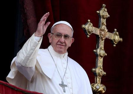 "FILE PHOTO: Pope Francis waves after delivering his ""Urbi et Orbi"" (to the city and the world) message from the balcony overlooking St. Peter's Square at the Vatican"