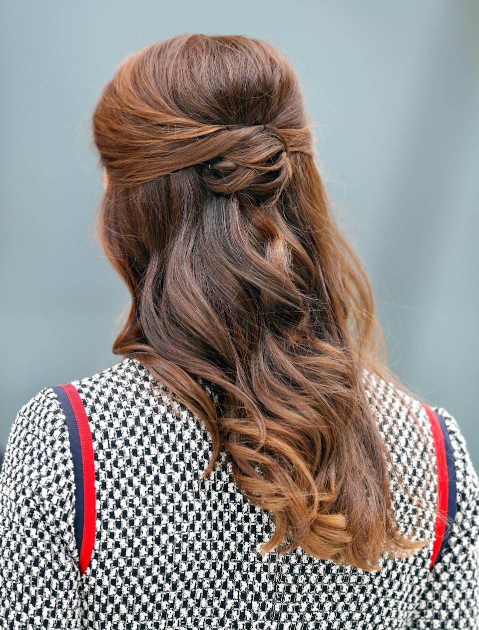 <p>Middleton switched up a normal half-up ponytail for one with small looped details and loose waves, the latter of which highlighted her caramel ombré highlights. </p>