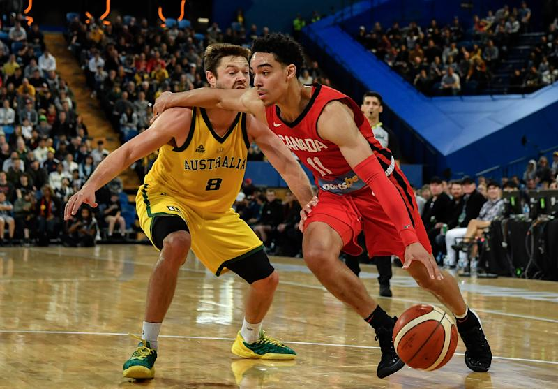 PERTH, AUSTRALIA - AUGUST 17: Andrew Nembhard of Canada drives to the basket against Matthew Dellavedova of Australia during the International Basketball friendly match between the Australian Boomers and Canada at RAC Arena on August 17, 2019 in Perth, Australia. (Photo by Stefan Gosatti/Getty Images)