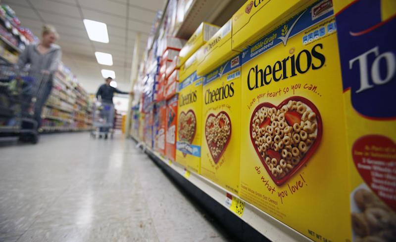 FILE - This June 16, 2011 file photo shows boxes of Cheerios in a store in Akron, N.Y. Large food companies are trying to head off state-by-state efforts to enact mandatory labeling of genetically modified ingredients by proposing new voluntary labels nationwide. The food industry and farm groups are pushing Congress to pass legislation that would require the Food and Drug Administration to create guidelines for the new labels, which food manufacturers could use. (AP Photo/David Duprey, File)