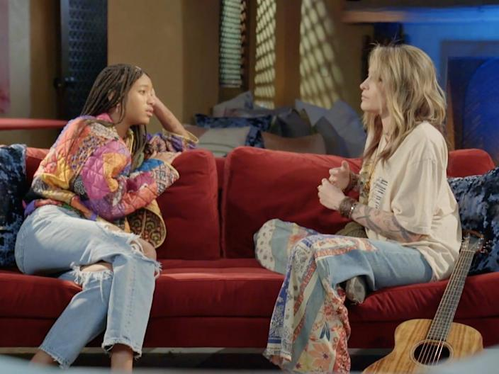 """Willow Smith and Paris Jackson sitting on a couch during the latest episode of """"Red Table Talk."""""""