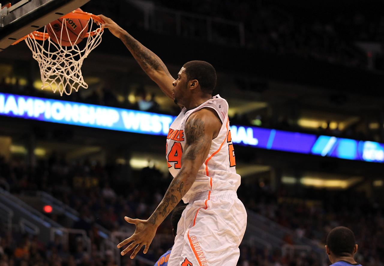 PHOENIX, AZ - MARCH 24:  Chane Behanan #24 of the Louisville Cardinals dunks the ball in the first half against the Florida Gators during the 2012 NCAA Men's Basketball West Regional Final at US Airways Center on March 24, 2012 in Phoenix, Arizona.  (Photo by Jamie Squire/Getty Images)
