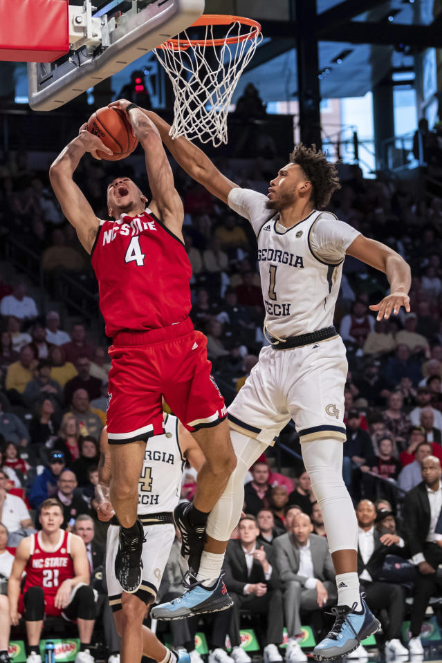 North Carolina State forward Jericole Hellems (4) shoots against Georgia Tech forward James Banks III (1) in the second half of an NCAA college basketball game Saturday, Jan. 25, 2020, in Atlanta. (AP Photo/Danny Karnik)