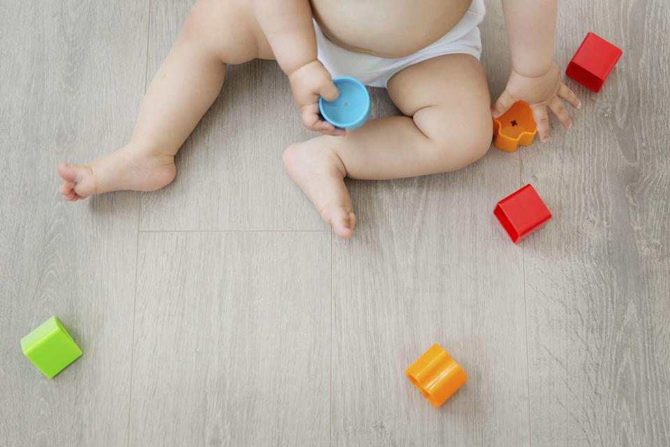 Parents and childminders can exchange information about learning, development and care of children on the app. Source: Mint Images/REX/Shutterstock