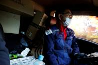 eong, a parcel delivery worker for Hanjin Transportation, drives his truck in Gwangju