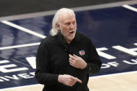 San Antonio Spurs coach Gregg Popovich watches during the first half of the team's NBA basketball game against the Utah Jazz on Wednesday, May 5, 2021, in Salt Lake City. (AP Photo/Rick Bowmer)