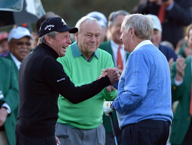 From left, Gary Player, Arnold Palmer and Jack Nicklaus shake hands after hitting ceremonial drives on the first tee during the first round of the Masters golf tournament Thursday, April 10, 2014, in Augusta, Ga. (AP Photo/Atlanta Journal-Constitution, Curtis compton)