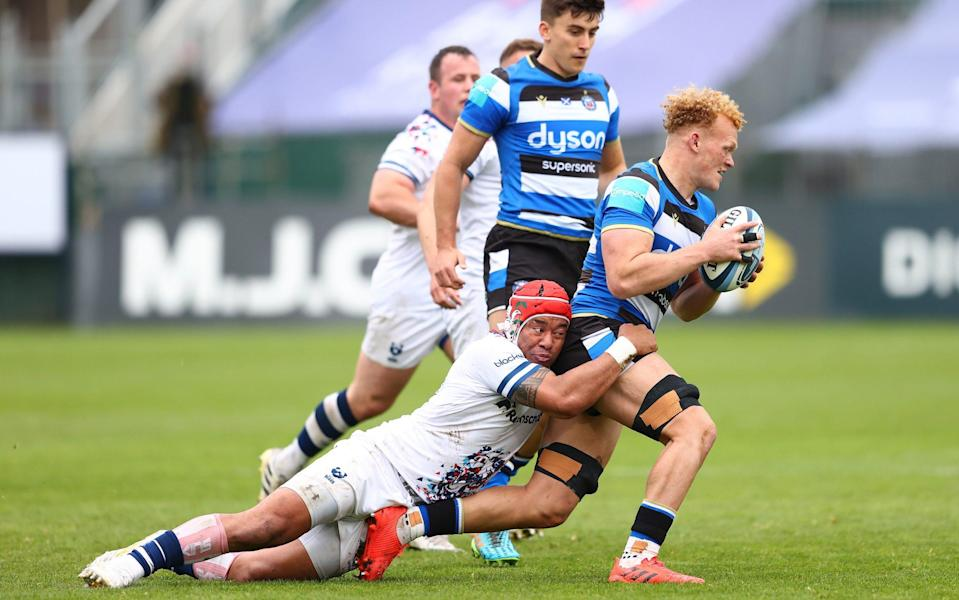 Miles Reid of Bath is tackled by Siale Piutau of Bristol - GETTY IMAGES