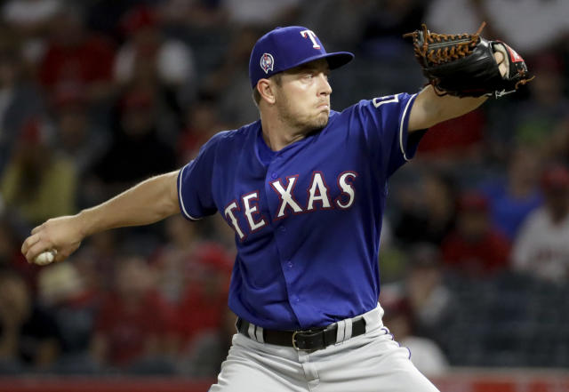 Texas Rangers starting pitcher Adrian Sampson throws against the Los Angeles Angels during the first inning of a baseball game in Anaheim, Calif., Tuesday, Sept. 11, 2018. (AP Photo/Chris Carlson)