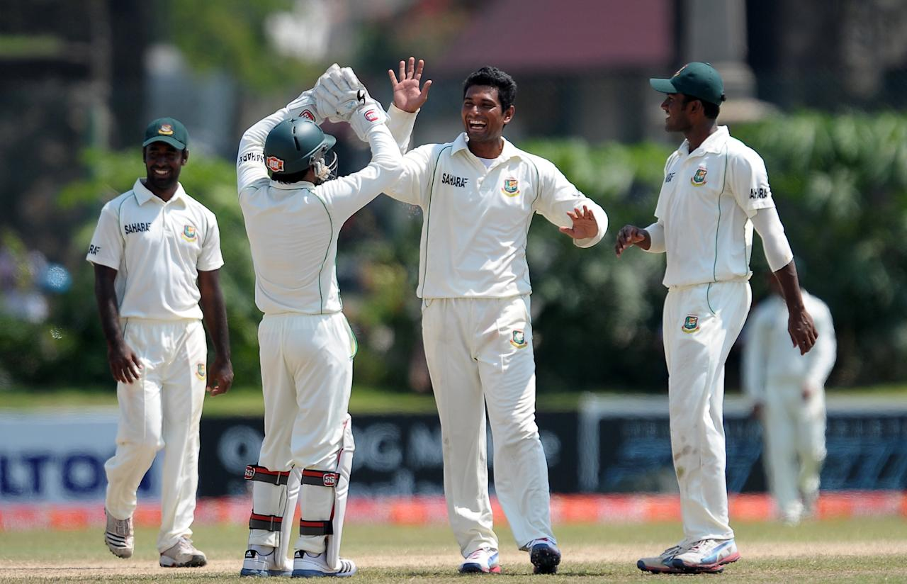Bangladeshi cricketer Mohammad Mahmudullah (C) celebrates with teammates after he dismissed Sri Lankan batsman Kithuruwan Vithanage during the final day of their opening Test match between Sri Lanka and Bangladesh at the Galle International Cricket Stadium in Galle on March 12, 2013.  AFP PHOTO/ LAKRUWAN WANNIARACHCHI        (Photo credit should read LAKRUWAN WANNIARACHCHI/AFP/Getty Images)