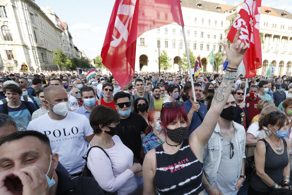 Protesters chant slogans as they rally in downtown Budapest, Hungary, Saturday, June 5, 2021. Thousands of people gathered opposing the Hungarian government's plan of building a campus for China's Fudan University in Budapest. (AP Photo/Laszlo Balogh)