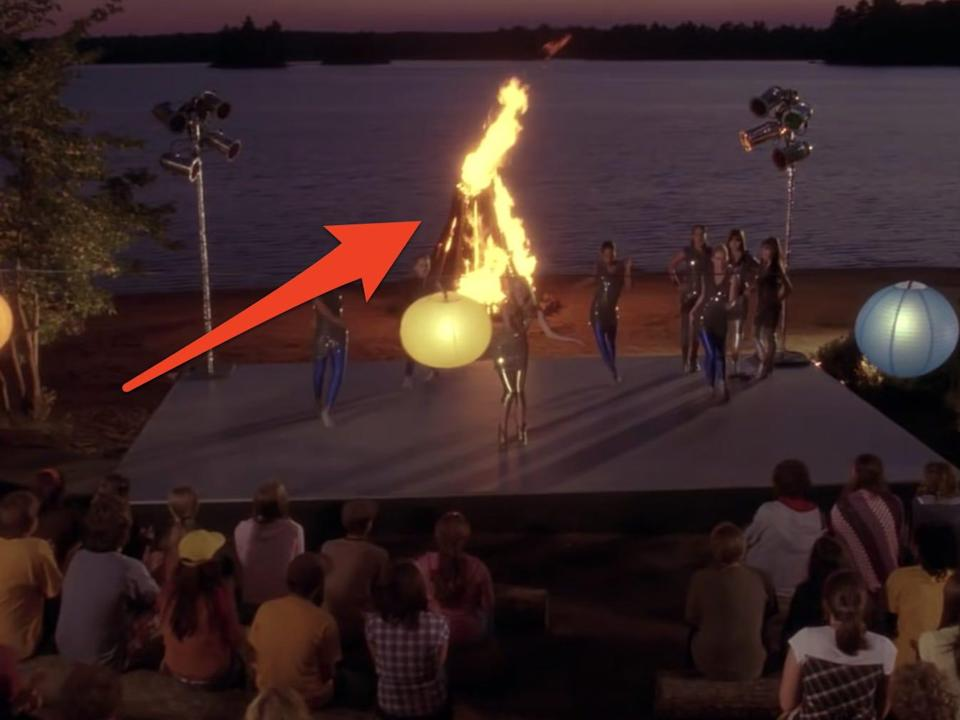 camp rock campfire jam scene with arrow pointing at bon fire