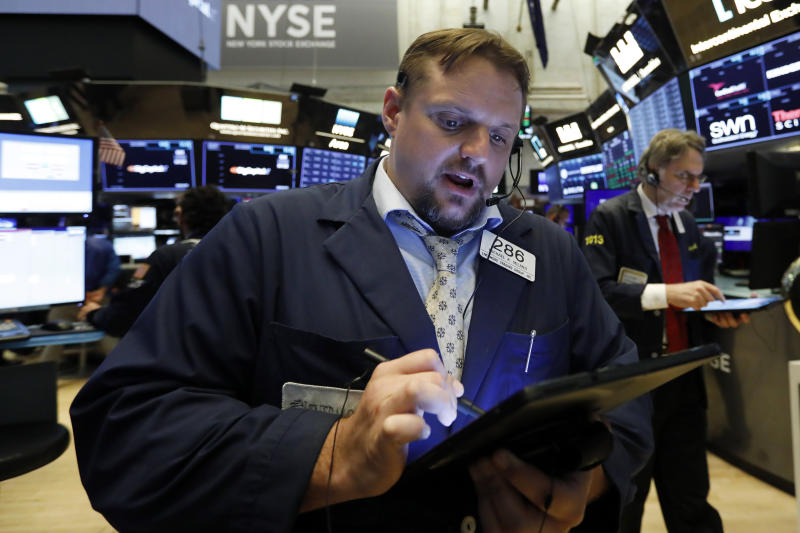 Trader Michael Milano works on the floor of the New York Stock Exchange, Tuesday, June 11, 2019. Stocks are rising early Tuesday as Wall Street continues to thrive in June. (AP Photo/Richard Drew)