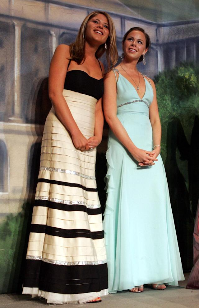 President Bush's daughters Jena, left, and Barbara look out at the guests attending the Black Tie and Boots Inaugural Ball in Washington, Wednesday, Jan. 19, 2005. (AP Photo/Pablo Martinez Monsavias)