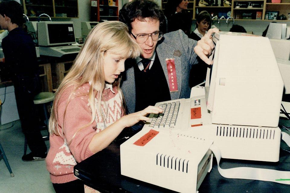 <p>An 11-year-old gets some instruction while typing away at a computer class. </p>