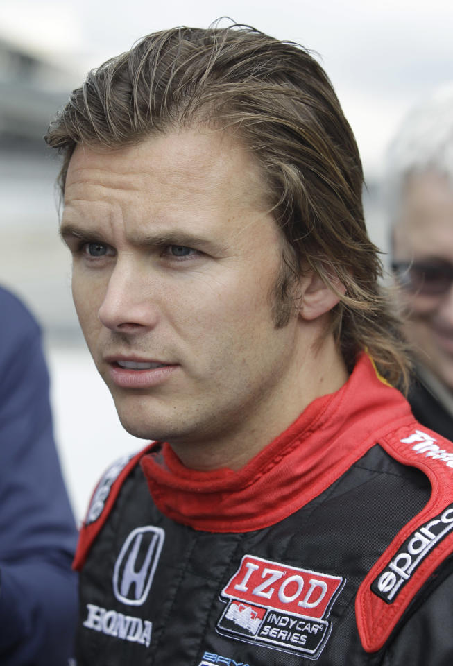 FILE - In this Sept. 27, 2011, file photo, Dan Wheldon talks about the 2012 IndyCar vehicle, at Indianapolis Motor Speedway in Indianapolis, Tuesday, Sept. 27, 2011. Wheldon died Sunday, Oct. 16, 2011 in a fiery 15-car wreck during the Las Vegas Indy 300. (AP Photo/Darron Cummings, File)