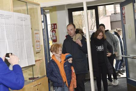 Chairman of the Finns Party and parliamentary candidate Jussi Halla-aho arrives with wife Hilla Halla-aho and two children to cast his vote in the parliamentary elections in Helsinki, Finland, April 14, 2019. Emmi Korhonen/Lehtikuva/via REUTERS