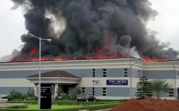 A still image taken from a video obtained by Reuters on October 21, 2020, shows the roof of TVC television station in flames, in Lagos, Nigeria. / Credit: REUTERS TV