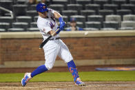 New York Mets' James McCann hits a two-run home run during the eighth inning of a baseball game against the Philadelphia Phillies Wednesday, April 14, 2021, in New York. (AP Photo/Frank Franklin II)