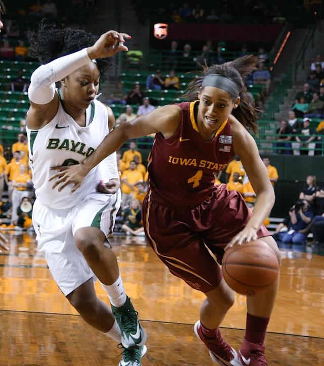 Iowa State guard Nikki Moody (4), right, drives to the basket on Baylor guard Odyssey Sims (0), in the first half of an NCAA college basketball game, Wednesday, Feb. 19, 2014, in Waco, Texas. (AP Photo/Rod Aydelotte)