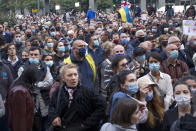 Supporters of the ex-President Mikhail Saakashvili's United National Movement, most of them wearing face masks to help curb the spread of the coronavirus, listen to a speaker during a rally to protest the election results in front of the parliament's building in Tbilisi, Georgia, Sunday, Nov. 1, 2020. Preliminary election results show that Georgia's ruling party won the country's highly contested parliamentary election, but the opposition have refused to recognize Sunday's results, saying they were manipulated. (AP Photo/Shakh Aivazov)