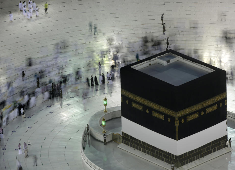 In this photo taken with low shutter speed, Muslim pilgrims circumambulate the Kaaba, the cubic building at the Grand Mosque, at the start the annual hajj pilgrimage, Sunday, July 18, 2021. The pilgrimage to Mecca required once in a lifetime of every Muslim who can afford it and is physically able to make it, used to draw more than 2 million people. But for a second straight year it has been curtailed due to the coronavirus with only vaccinated people in Saudi Arabia able to participate. (AP Photo/Amr Nabil)