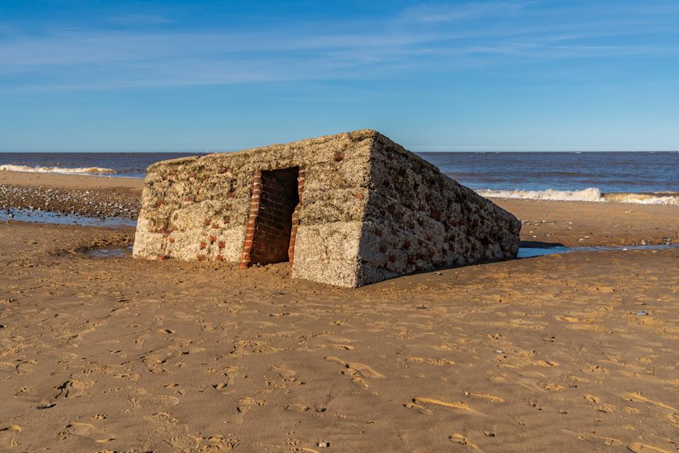 North sea coast in Caister-on-Sea, Norfolk, England, UK -  with an old bunker on the beach