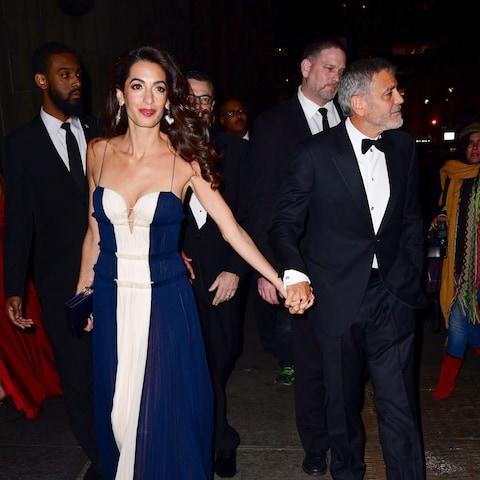 Amal Clooney and George Clooney leave the dinner after he gives her speech - Credit: James Devaney